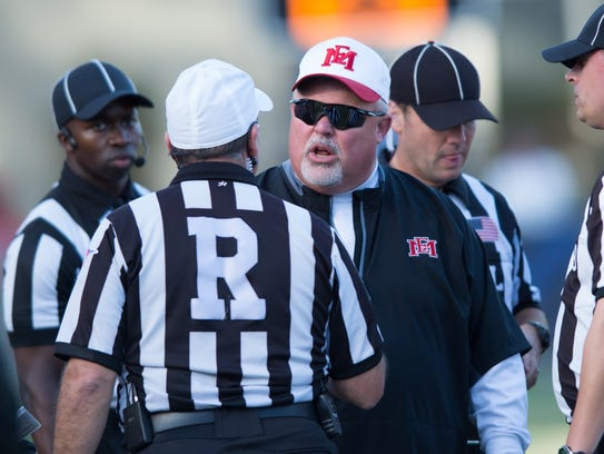 EMCC Coach Buddy Stephens disputes a call during Saturday's