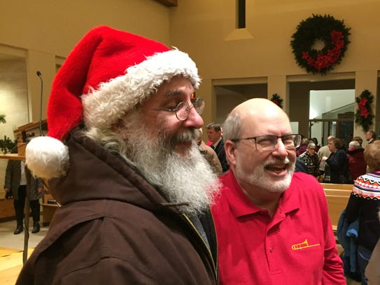 Jerry Heilner, in the red shirt, laughs with concertgoers after a Jan. 5 performance at Derry Presbyterian Church in Hershey.