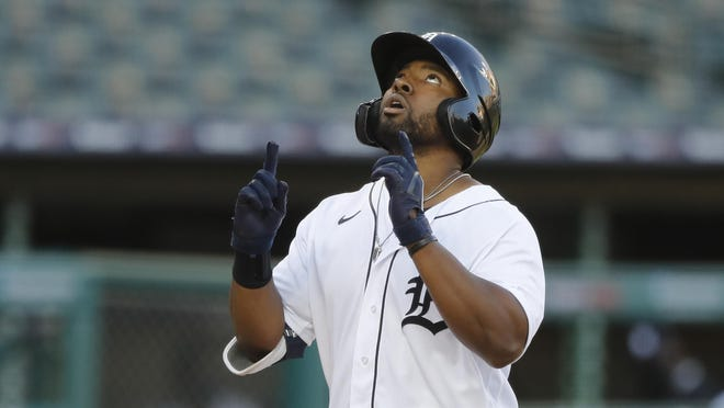 Detroit Tigers' Christin Stewart looks skyward as he approaches home plate after his two-run home run during the third inning of a baseball game against the Kansas City Royals, Tuesday, July 28, 2020, in Detroit.