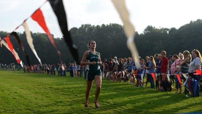 Green Bay Notre Dame junior Maria Ehlinger takes her final strides as she finishes the Green Bay City Meet race in first with a time of 19:44.32 at Colburn Park in Green Bay, Wis. on Thursday, Sept. 17, 2015.