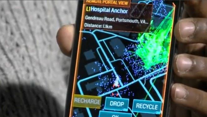 Crystal Grause holds her Android smartphone loaded with 'Ingress.'