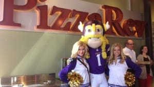 Ragnar the Viking and some of the Minnesota Vikings cheerleaders were at the ribbon-cutting for the first PizzaRev in Minnesota.