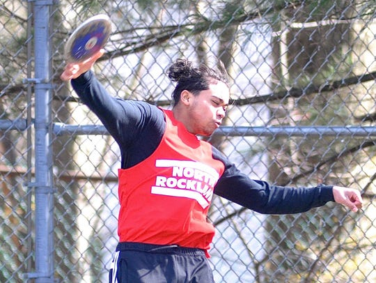 North Rockland's Enrique Portorreal throws the discus