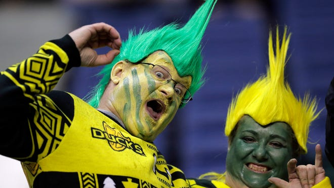 Oregon fans pose for a photo prior to the team's Alamo Bowl NCAA college football game against TCU, Saturday, Jan. 2, 2016, in San Antonio.