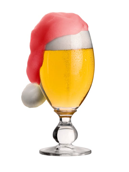 glass of christmas beer with jelly back cap