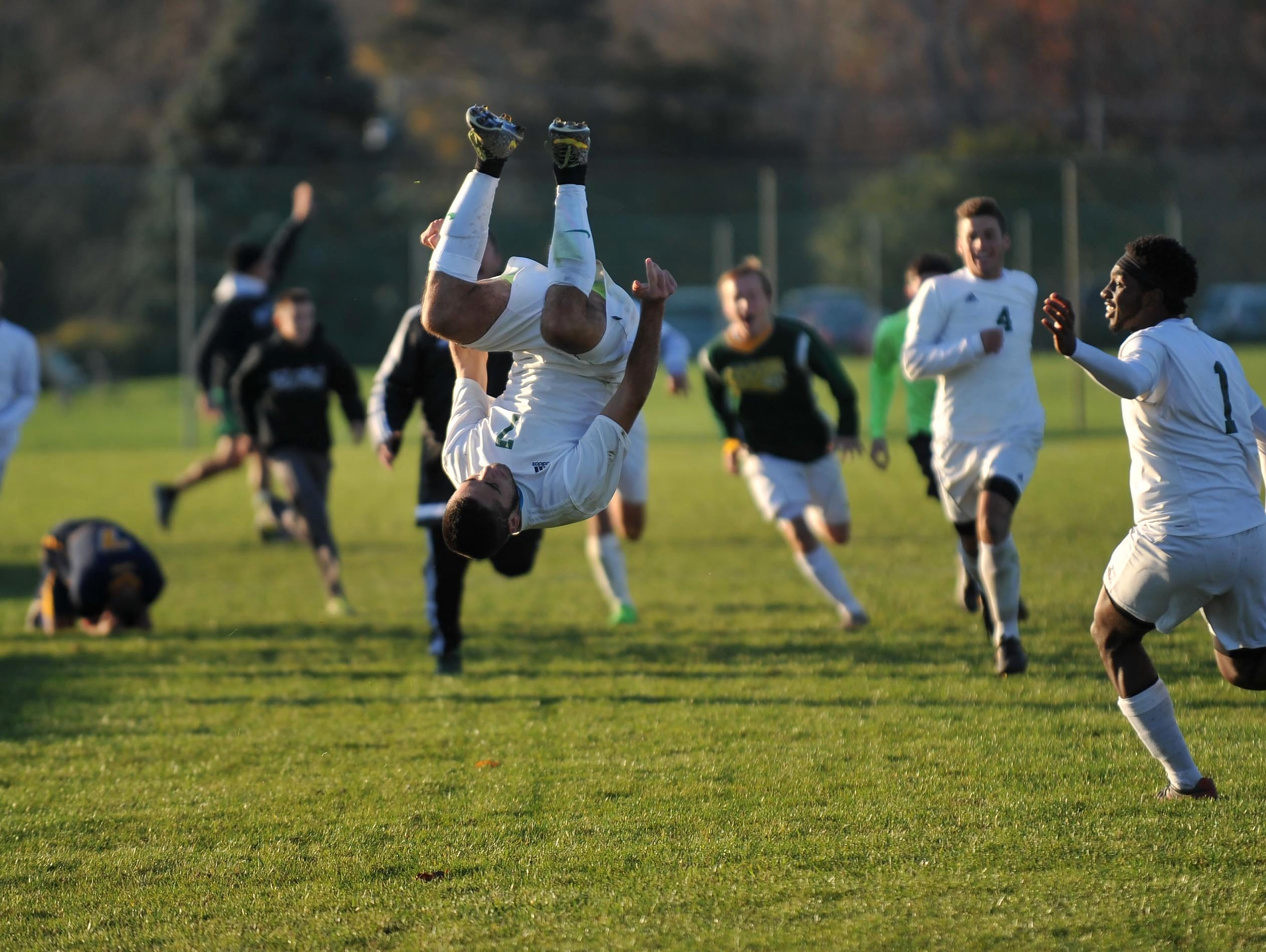 Schalick's Michael D'Orio (7) reacts with a front flip after scoring the winning goal over Lindenwold, in overtime, Friday, Nov. 13 in Pittsgrove.