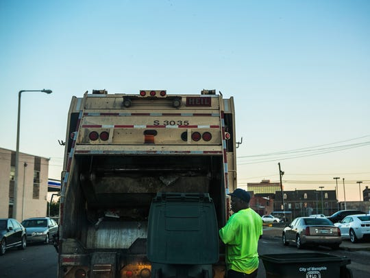 July 10, 2017 - Steve London, an employee with City of Memphis' Solid Waste Management, collects trash in downtown Memphis on Monday. The Memphis city government is planning to pay $50,000 grants to the surviving sanitation workers who marched with Dr. Martin Luther King Jr. in 1968.