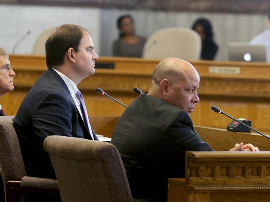 (From right:) City Manager Harry Black, Assistant City Manager John Juech and Jim Goetz of the city's audit team listen to questions during the rules and audit committee meeting at City Hall on Tuesday.