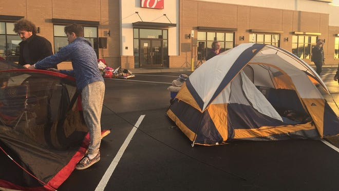 People set up their tents to wait in line for the chance to get free Chick-fil-A for a year at the soon-to-be-open Millsboro location.