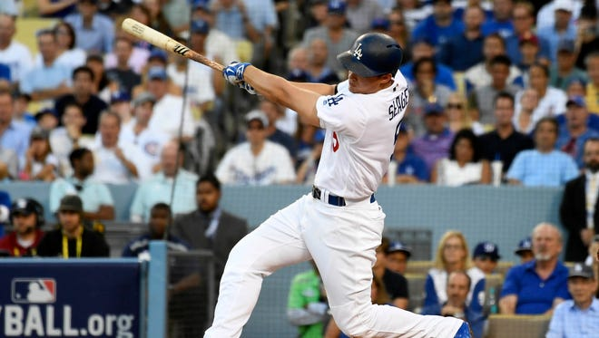 Oct 20, 2016: Los Angeles Dodgers shortstop Corey Seager (5) connects for a base hit in the first inning against the Los Angeles Dodgers in game five of the 2016 NLCS playoff baseball series against the Los Angeles Dodgers at Dodger Stadium.