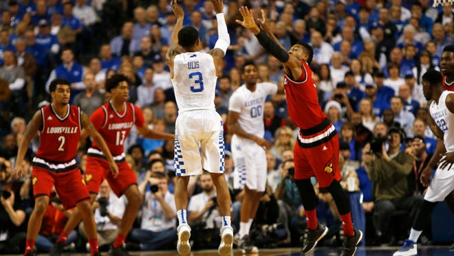 Kentucky Wildcats guard Tyler Ulis (3) shoots during the first half against the Louisville Cardinals guard Trey Lewis (3) at Rupp Arena.