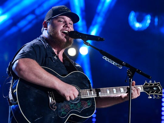 Luke Combs performs at the 2018 CMA Music Fest Friday, June 8, 2018, at Nissan Stadium in Nashville, Tenn.