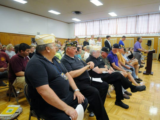 Nelson Eddy Rivera, far right, director of Dutchess County Veterans' Services, speaks at an Arlington School Board meeting on June 23. Arlington School District is one of the few districts in the area that doesn't give veterans a property tax exemption. Sitting in the front row are veterans of various conflicts who have also come to voice their opinions on the subject.