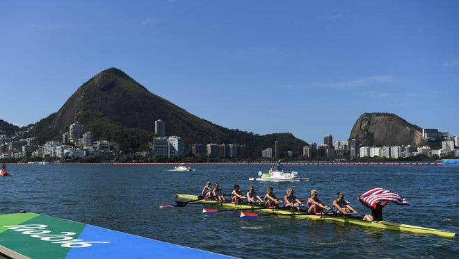 Team USA celebrates winning gold in women's eight rowing competition.