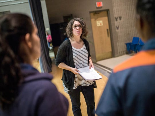 """Frannie Shepherd-Bates, Director of the Shakespeare in Prison program, talk with participants during the rehearsal of Shakespeare in Prison's """"Othello"""" play in May 2016, at the Women's Huron Valley Correctional Facility in Ypsilanti."""