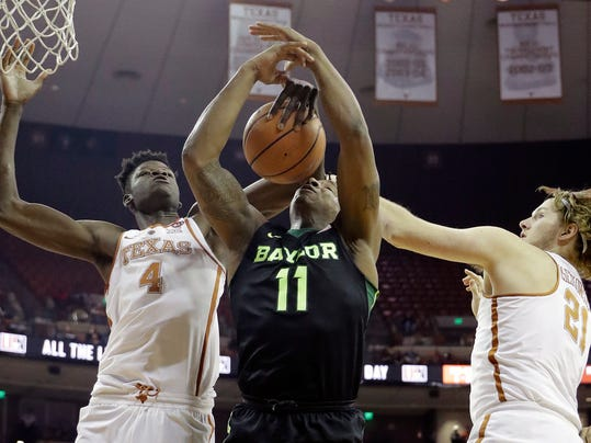 Baylor forward Mark Vital (11) battles Texas forward Mohamed Bamba (4) and forward Dylan Osetkowski (21) for a rebound during the first half of an NCAA college basketball game, Monday, Feb. 12, 2018, in Austin, Texas. (AP Photo/Eric Gay)