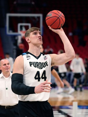 Purdue center Isaac Haas shoots during warmups before a second round game against Butler in the NCAA college basketball tournament, Sunday, March 18, 2018, in Detroit. A day after Isaac Haas' season was declared over, there's now a bit of mystery surrounding the status of Purdue's star center. That could be encouraging news for the second-seeded Boilermakers, who announced Friday that Haas would miss the rest of the NCAA Tournament with a broken elbow. On Saturday, a CBS reporter tweeted that Haas had practiced with the team, although coach Matt Painter tried to keep expectations low for a possible return.