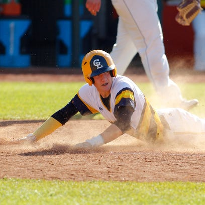 Grand Ledge's Braedon Stoakes slides into home after