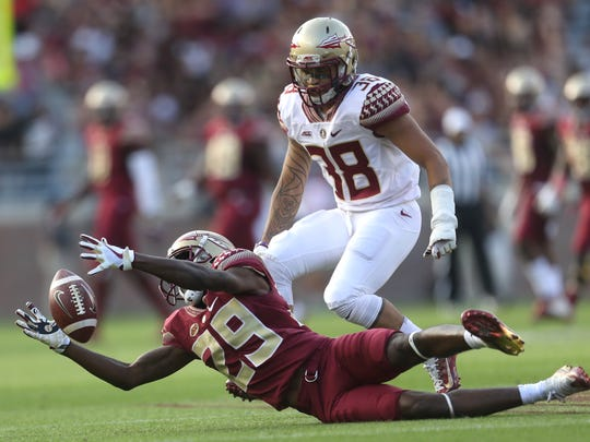 FSU's D.J. Matthews dives for a loose punt duirng the Garnet and Gold Spring Game at Doak Campbell Stadium on Saturday, April 14, 2018.