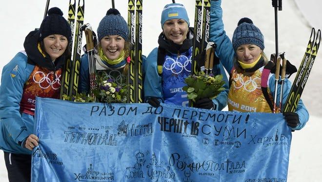 From left: Ukraine's Vita Semerenko, Juliya Dzhyma, Olena Pidhrushna and Valj Semerenko celebrate after winning gold in the women's biathlon relay at the Laura Cross-Country Ski and Biathlon Center during the Sochi Winter Olympics.