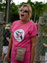 Honor Flight board member Nina Iraggi reacts to sinking a putt.