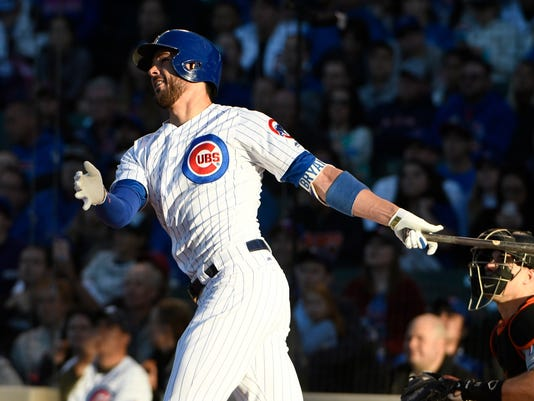 Chicago Cubs' Kris Bryant (17) hits a two-run home run against the Miami Marlins during the first inning of a baseball game, Monday, June 5, 2017, in Chicago. (AP Photo/David Banks)