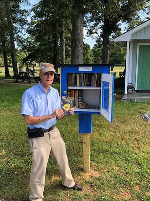 """New River Rotary Club have been constructing """"Little Libraries"""" for Jacksonville. Members have installed the libraries and have begun to fill each library with assorted books for children and adults. Little Libraries are free and provide 24/7 access to books and encouraging a love of reading."""