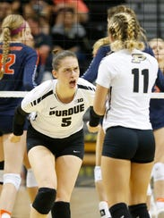 Ashley Evans celebrates a point against Illinois.