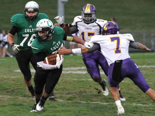 Clear Fork's Ian Mcdanel attempts to outmaneuver the Lexington defense during a home game Friday night.