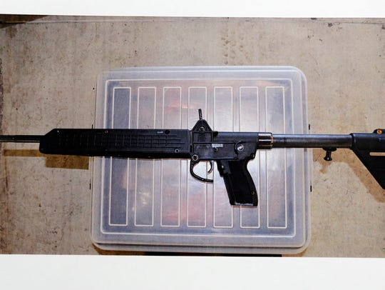Gun recovered from suspects car after shooting.
