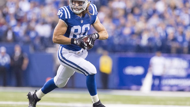 Indianapolis Colts tight end Coby Fleener (80) rushes the ball upfield during the second half of an NFL football game Sunday, Nov. 29, 2015, at Lucas Oil Stadium. Colts won 25-12.