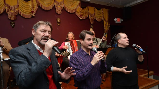 FILE IMAGE: At the Blue Dog Café in Snow Hill, from left, Mike Pruitt, Gary Weber and Todd Crosby sing to their customers as WWTunes plays behind the trio in 2014.