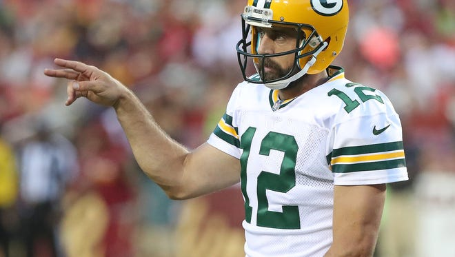 Green Bay Packers quarterback Aaron Rodgers gestures to the sideline against Washington on Saturday, Aug. 19, 2017 at Fedex Field in Landover, Md.