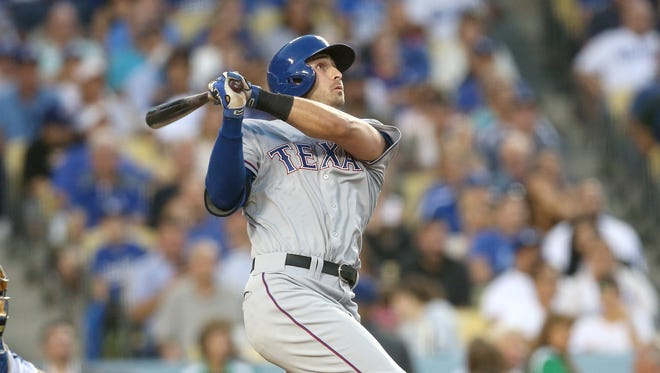 Joey Gallo of the Texas Rangers hits a two-run home run.
