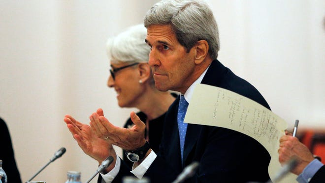 U.S. Secretary of State John Kerry and U.S. Under Secretary for Political Affairs Wendy Sherman, center, meet with foreign ministers and representatives of Germany, France, China, Britain, Russia and the European Union during the current round of nuclear talks with Iran, being held in Vienna, Austria.