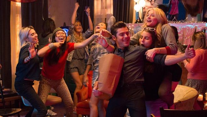 "Teddy (center, Zac Efron)  befriends a crew of college girls in ""Neighbors 2: Sorority Rising."""