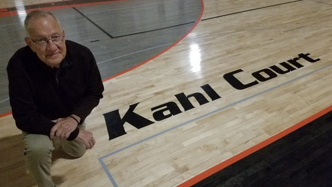 Ron Kahl, who has volunteers at athletic events in Burllington for 55 years, had the school's basketball court named in his honor.