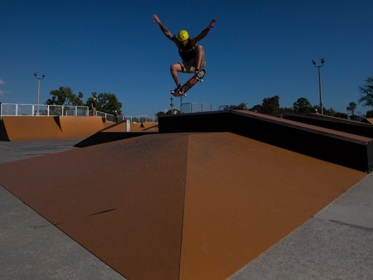 Sam Hunt uses one of the new metal ramps while visiting Eagle Skate Park in Cape Coral on Friday afternoon, April 6, 2018.