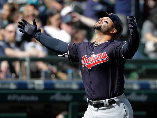Cleveland Indians' Yonder Alonso looks up as he nears home plate after he hit a grand slam during the first inning of a baseball game against the Seattle Mariners, Saturday, March 31, 2018, in Seattle. (AP Photo/Ted S. Warren)