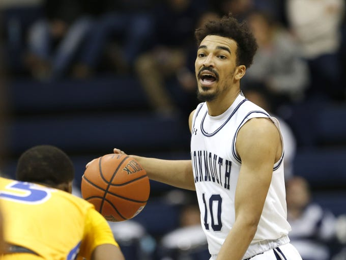 Monmouth Hawks guard Micah Seaborn (10) dribbles the
