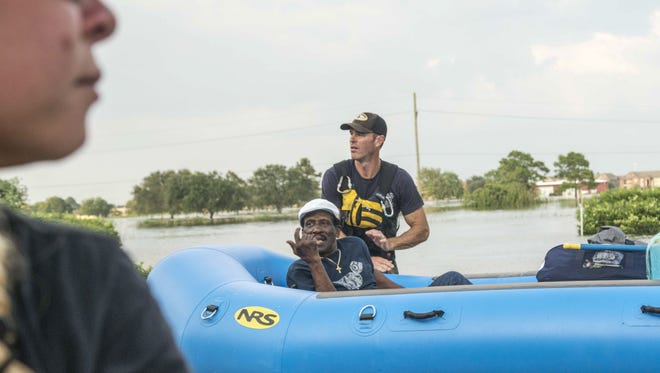 08/31/2017 -- Port Arthur, TX. Mia Adams, 30, in front, left her home near Amarillo, Texas, to join in the rescue efforts across Texas. A business provided a boat and motor to Adams and her friend, Christy Reyes, and the women helped rescue dozens of people in Port Arthur. Photo by Nick Oza, Gannett