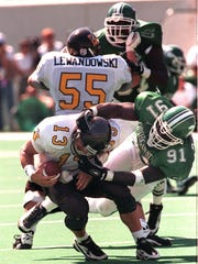 Former Michigan State defensive end Robaire Smith takes down former Western Michigan quarterback Tim Lester in the 1997 opener at Spartan Stadium.