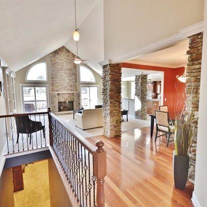 This $390K ranch home in West Lafayette has stone pillars