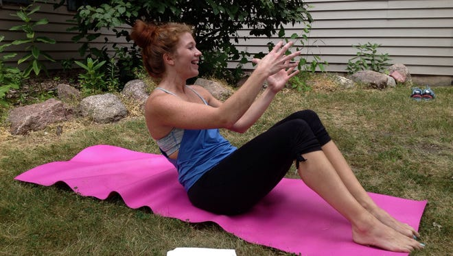 Yoga instructor Amanda Boeder leads a class outside the Golden House domestic violence shelter in Green Bay.