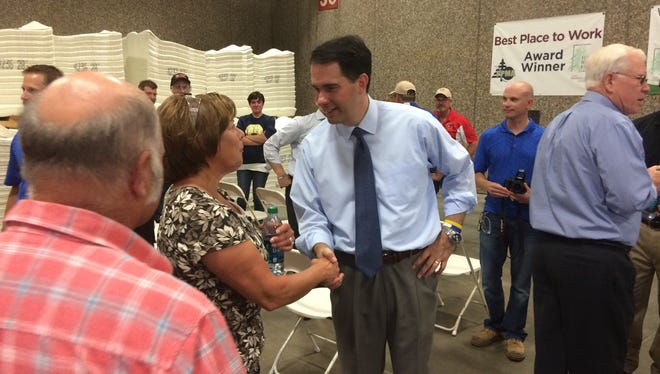 Wisconsin Gov. Scott Walker, right, made a 2014 campaign stop at Fox River Fiber Co. in De Pere. The company is nominated for a Wisconsin Manufacturer of the Year award.
