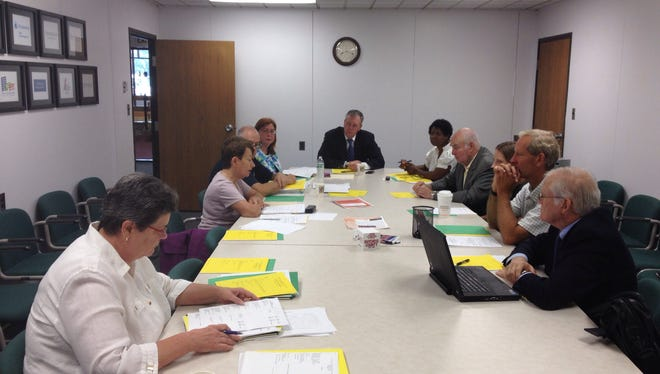 Compliance with state rules has become a big topic for the Dutchess County Industrial Development Agency and others like it in New York state. Here, members of the IDA board and staff discuss how to pay the rising cost of compliance at an Aug. 26 meeting.