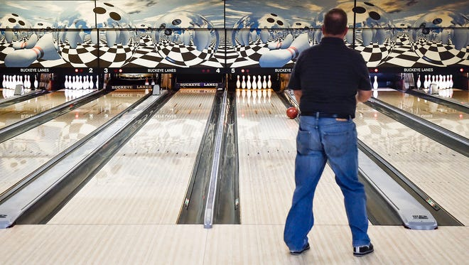 The new synthetic lanes at Buckeye Lanes are put to the test on Wednesday evening as the Schoolmasters League competes at the 90-year old downtown facility.