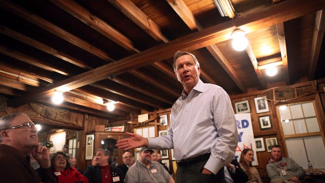 "Gov. John Kasich has hired two national strategists to help with his expected presidential bid. Here, Kasich speaks to a crowd at The Snow Shoe Club for ""Politics & Pie"" in Concord, N.H., Tuesday, March 24, 2015. The Enquirer/ Meg Vogel"