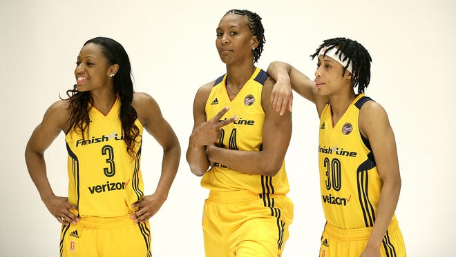 Indiana Fever forward Tamika Catchings (24) flashes the peace sign as she poses for a photo with guard Brene Moseley (30) and guard Tiffany Mitchell (3) during the Indiana Fever Media day Monday, May 9, 2016, morning at Bankers Life Fieldhouse.
