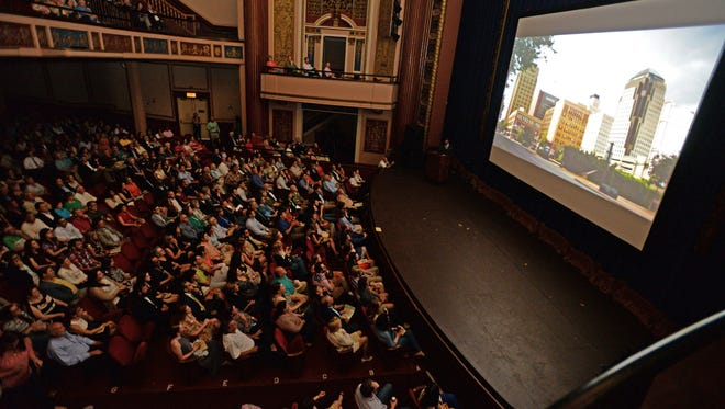 Theater goers watch as the introduction for The Shape of Shreveport is played during the documentary series premiere at The Strand Theatre in June. Episodes 5-8 will debut Thursday.